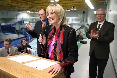 In this April 2011 photo, Mayor Shari Decter Hirst comments during an announcement that the province is spending $500,000 — with the city matching those funds — to refurbish the Sportsplex pool as part of Brandon's efforts to land the 2017 Canada Summer Games. The bid ultimately failed, in part because the pool was deemed to be below national standards. At rear, from left: Swim Manitoba's Darin Muma, Brandon Bluefins' Darcy Smith, Brandon East NDP MLA Drew Caldwell and Premier Greg Selinger.
