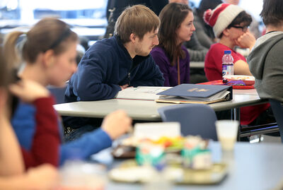 Students attend a residence and food services forum at Brandon University on Tuesday.
