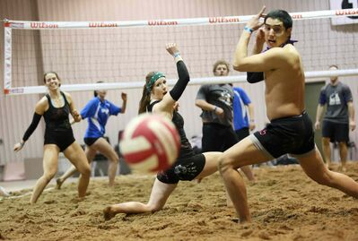 Lindsay Braul, Leah Shevkenek and Marco Vargas with team Under Hand Jobs watch as the ball flies out of bounds during the Sun of a Beach volleyball tournament at the Keystone Centre on Friday.