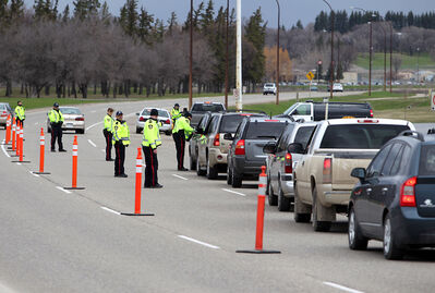 Brandon Police Service officers conduct a roadside checkstop along First Street near Dinsdale Park earlier this month. The checkstop kicked off national Road Safety Week.