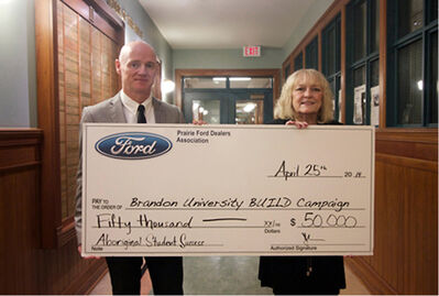 John Kelleher, of Kelleher Ford Sales Brandon, presents a cheque for $50,000 to Brandon University president Deborah Poff on behalf of the Prairie Ford Dealers Association.