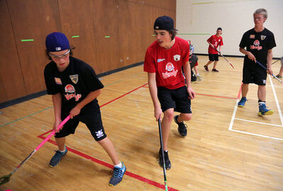 Curtis Ireland (left) and Sam Huston compete during the first week of the Floorball Brandon season. Now in its third season, the local league has grown steadily in registrations each year.