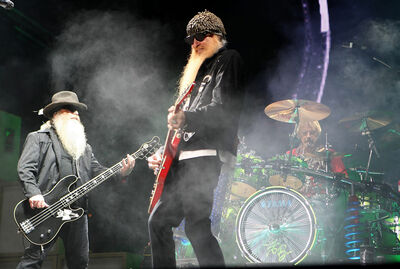 Left to right, Billy Gibbons, Dusty Hill and Frank Beard of American blues rock trio, ZZ Top, perform in 2010.
