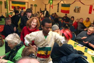 Dancers bring up audience members to join in the fun at the Ethiopian pavilion on Friday night.