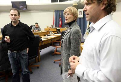 From left: Coun. Corey Roberts (Rosser), Mayor Shari Decter Hirst, Coun. Jeff Fawcett (Assiniboine) and (background) city manager Scott Hildebrand chat in council chambers before a meeting with Renaissance Brandon on Tuesday evening.