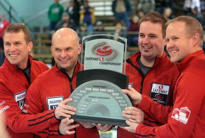 Jeff Stoughton and teammates John Mead, Reid Carruthers and Mark Nichols celebrate their win over the Sean Grassie rink at the Safeway Provincial Men's Curling Championship in Neepawa on Sunday.