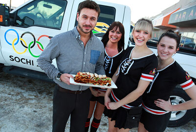 """From left, Dan Barnlund, Julie Dyck, Kristjana Schure and Jen Burton help raise funds for the Sexuality Education Resource Centre with a """"Putin Poutine"""" special at Joe Beeverz."""