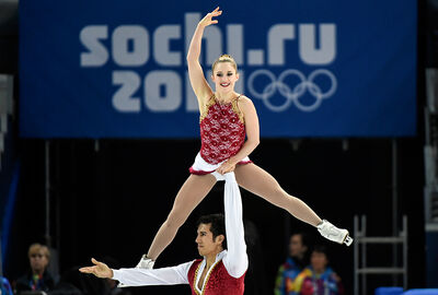 Rudi Swiegers lifts Paige Lawrence as the Virden pairs skaters complete their free skate Wednesday in Sochi, Russia.