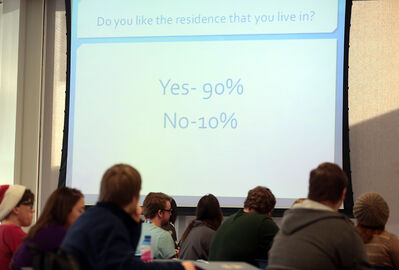 Brandon University students listen during a presentation at a residence and food services forum in the university cafeteria on Tuesday. Students had a chance to voice their concerns to a panel of university administrators and program directors.