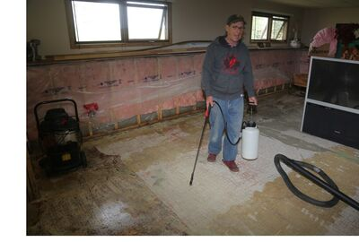 Garth Hoy sprays to combat mould in his basement in the city's southeast. Hoy has been frustrated for weeks by water seeping into the basement of his Patricia Avenue home, which he believes is caused by the city pumping water from a retention pond near Crocus Plains high school to nearby land.