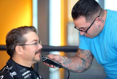 Bladeworx Barber/Salon barber Jesse Spence trims the facial hair off ACC instructor Chad Bicklmeier during Thursday's Movember Challenge at the Len Evans Centre for Trades and Technology. Bicklmeier will have to start from square one, having had his moustache for the past 30 years. However, growing it back isn't a problem and will help raise money for the annual prostate cancer fundraiser and awareness campaign.