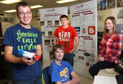 Crocus Plains high school students (from left) Evan Melanson, Jevon Swallow, Jordan Dyck and Paige Kasprick are headed to Abu Dhabi to test their car design in a competition.