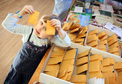 Autumn Smith holds up packets of sunflower seeds she bought during Seedy Sunday at the Park Community Centre in February 2011. This year's event is called Seedy Saturday as it will be held this Saturday at Brandon's Central United Church.