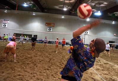 Glen Saunders serves the ball during the opening hours of the Sun of a Beach indoor volleyball tournament in the Keystone Centre's Manitoba Room on Friday afternoon.
