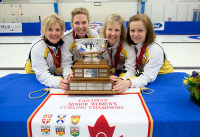 Lois Fowler, Maureen Bonar, Cathy Gauthier and Allyson Stewart celebrate their Canadian senior women's curling championship in Yellowknife, N.W.T., after beating Saskatchewan's Lorraine Arguin 5-1 in the final on Saturday.