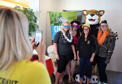 Michelle Kolisnyk, Becky LeBlanc, Stacey Sherritt and Ashley Bell have their photo taken with mascot CACCey the Cougar during a Welcome Back lunch for Assiniboine Community College students at the Victoria Avenue East campus on Tuesday.
