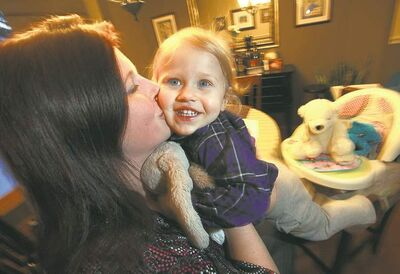 Phil Hossack / Winnipeg Free PressAmber Anderson plays with daughter, Jocelyn. She had to find a daycare on the website Kijiji after being dissatisfied with the provincial online registry.