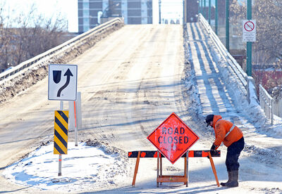 A barricade is positioned on the north side of the Eighth Street Bridge on Tuesday.