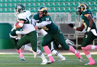 Brandonite Connor Ketchen (middle) of the Regina Rams tackles a U of SHuskies running back in the 2013 season.