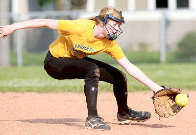 Jenna Marshall reaches for a grounder during practice with the U14 Westman Magic girls' softball team.