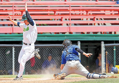 Pearce McDonald of the Brandon Cloverleafs slips past catcher Duncan Paddock of the Oak River Dodgers to score a run during Manitoba Senior Baseball League action at Andrews Field on Sunday afternoon. The Cloverleafs won the game 6-1.