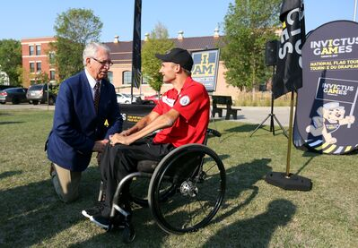 Brandon-Souris Conservative MP Larry Maguire visits with retired soldier Chris Klodt, who was injured during a tour in Afghanistan, during the Invictus Games Toronto 2017 National Flag Tour stop at the Brandon Armoury on Wednesday. Klodt will be competing in the 2017 Games as part of team Canada's wheelchair rugby team.