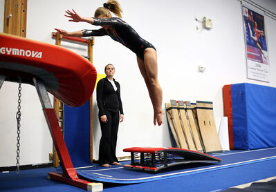 Amber Pomeroy of the Brandon Eagles competes in the vault event on Saturday.