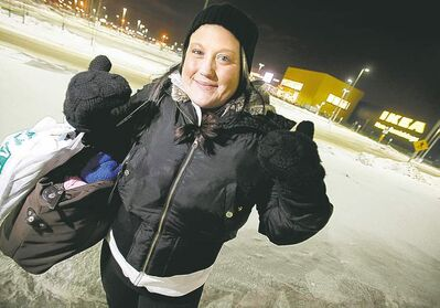 John Woods / Winnipeg Free PressA well-prepared Chantal Drury�s spirits are high despite the cold and long wait to get into the new IKEA.