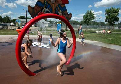 Avery Praznik runs through the spray at the new Westridge Spray Park on Silver Birch Drive on a scorching hot July afternoon. City figures show more than 18,600 visitors used Brandon's three spray parks over the summer.