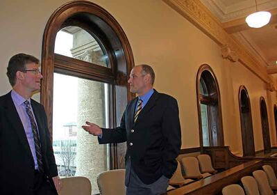 Justice Minister Andrew Swan and Brandon East NDP MLA Drew Caldwell take a look at the new windows at the Brandon courthouse during a tour of the building Wednesday.