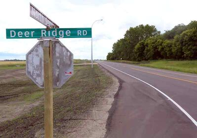 A newly built service road lies north of the Trans-Canada Highway, near Deer Ridge Road. The long-term highway redevelopment plan would take out roughly six of the nine holes at Deer Ridge Golf Course.