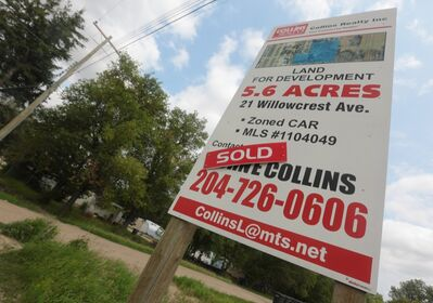 A development sign stands adjacent to the Kingsway Kort mobile home park in Brandon's south end on Friday. The deal to redevelop the property has been scrapped.