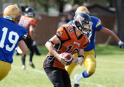 Westman Wolverines quarterback Seth Hume takes off with the ball during Manitoba Major Football League action at the Vincent Massey high school field on Saturday afternoon.