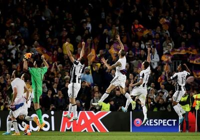 Juventus players celebrate at the end of the Champions League quarterfinal second leg soccer match between Barcelona and Juventus at Camp Nou stadium in Barcelona, Spain, Wednesday, April 19, 2017. The game ended in a goal less draw and Juventus advances after their first leg win. (AP Photo/Emilio Morenatti)