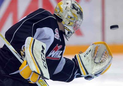 Brandon Wheat Kings goalie Corbin Boes makes a save in practice on Tuesday at Westman Place. The Wheat Kings open a three-game road trip tonight against the Kootenay Ice.