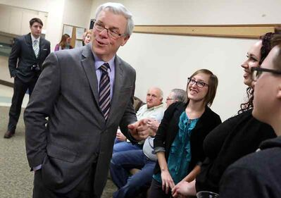 Premier Greg Selinger greets Brandonites at the Westman New Year Open House at the Riverbank Discovery Centre on Tuesday afternoon.