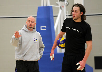 Head coach Grant Wilson talks to middle Frank Jones during a Brandon University men's volleyball team practice at the Healthy Living Centre this week. The Bobcats left on Thursday to compete in the Canada West final four in Langley, B.C.