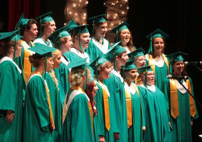 "Members of the Neelin Choir Grads perform the song ""Hello, Goodbye"" during the opening of the yesterday's Ecole Secondaire Neelin High School's graduation ceremony held at the Western Manitoba Centennial Auditorium."