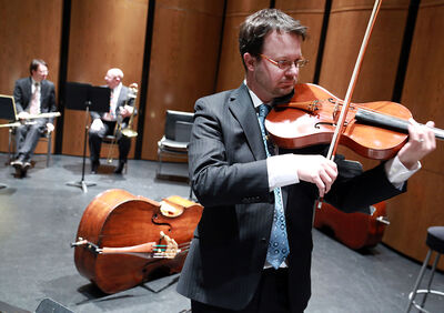 "Former Brandonite and violinist Greg Hay practises before a performance by the Winnipeg Symphony Orchestra at the Western Manitoba Centennial Auditorium on Sunday. Under a WSO ""adopt-a-musician"" campaign, Hay will get the chance to perform at New York's Carnegie Hall in May."