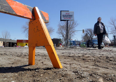 A pedestrian walks past the site of the former Brandon Inn, at Ninth Street and Princess Avenue, on Tuesday afternoon.