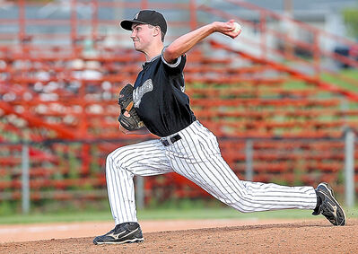 Marlins pitcher Shane MacGranachan delivers during Sunday night's game against the Oak River Dodgers at Andrews Field.