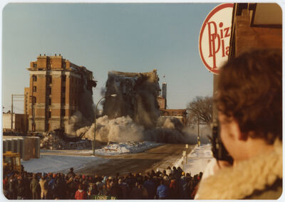 Spectators watch as the west half of the Prince Edward Hotel is imploded on Sunday afternoon, Feb. 24, 1980.