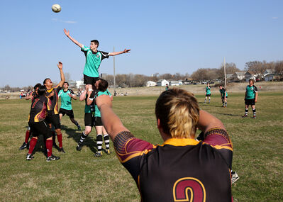Liam Barron with the Crocus Plainsmen throws the ball during a line out in Westman High School Rugby action against the Elton Sabres at John Reilly Field on Friday.