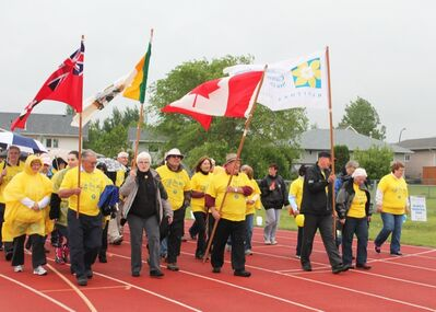 Cancer survivors take the first lap at the annual Relay for Life event at the Sportsplex Track on Saturday evening.