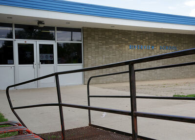Asbestos tape is being removed from the ductwork at Riverview School as part of an estimated $1.1-million project to replace a heating system.