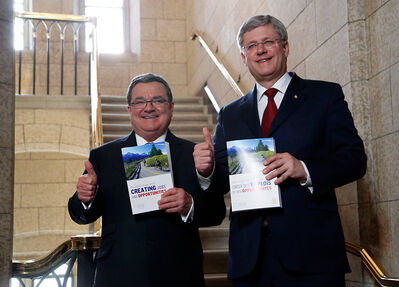 Finance Minister Jim Flaherty and Prime Minister Stephen Harper enter the House of Commons on budget day on Parliament Hill in Ottawa on Tuesday. Lynne Fernandez gives the Conservative budget two thumbs down because it does nothing to help working Canadians.