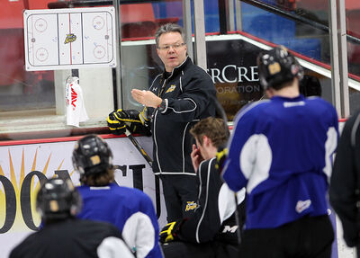 Wheat Kings coach Kelly McCrimmon diagrams a play in practice on Thursday at Westman Place.