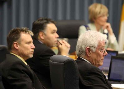 City councillors Len Isleifson, left, and Jim McCrae, right, along with city manager Scott Hildebrand and Mayor Shari Decter Hirst listen to presentations at city hall on Monday.