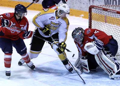 Brandon Wheat Kings forward Taylor Cooper takes a point-blank shot on Lethbridge Hurricanes goaltender Ty Rimmer — a former Wheat King — during Western Hockey League action on Wednesday night at Westman Place.