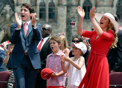 """Prime Minister Justin Trudeau, his children Xavier and Ella-Grace, and wife Sophie Gregoire Trudeau cheer during Canada Day festivities on Parliament Hill last year. Auriat contends that the outrage over the Trudeaus' and Pallisters' vacations is """"a tad rich and, respectfully, manufactured."""""""